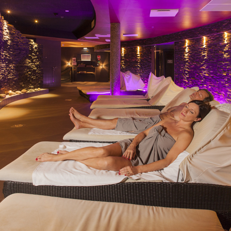 couple relaxing in sauna world squ.jpg