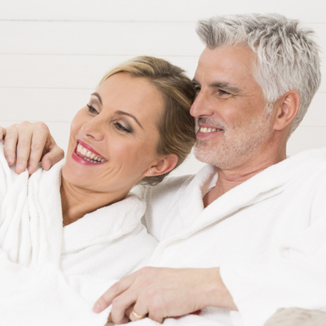 couple smiling in bath robes squ.jpg